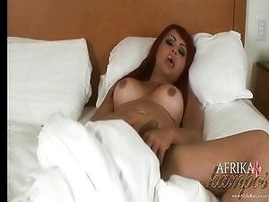 TS pornstar Afrika Kampos jacing off in bed