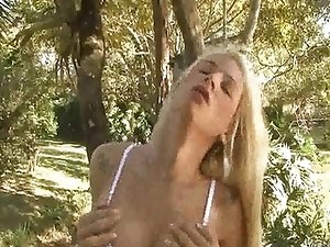 Yummy blonde tranny babe tugging her cock out