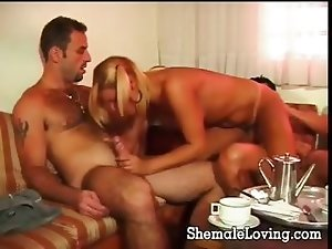 Lovely shemale enjoying a threesome