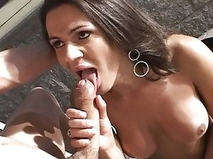 Brunette TS doing blowjob outdoor